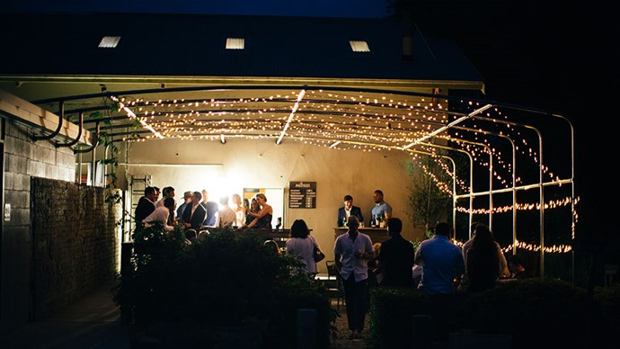 <strong>On the style of reception: </strong> <br></br> We did canapé style. My pet peeve at weddings is getting stuck next to someone that you're not familiar with, so I wanted to be able to walk around as much as possible and make use of the outdoor courtyard that we covered in fairy lights.