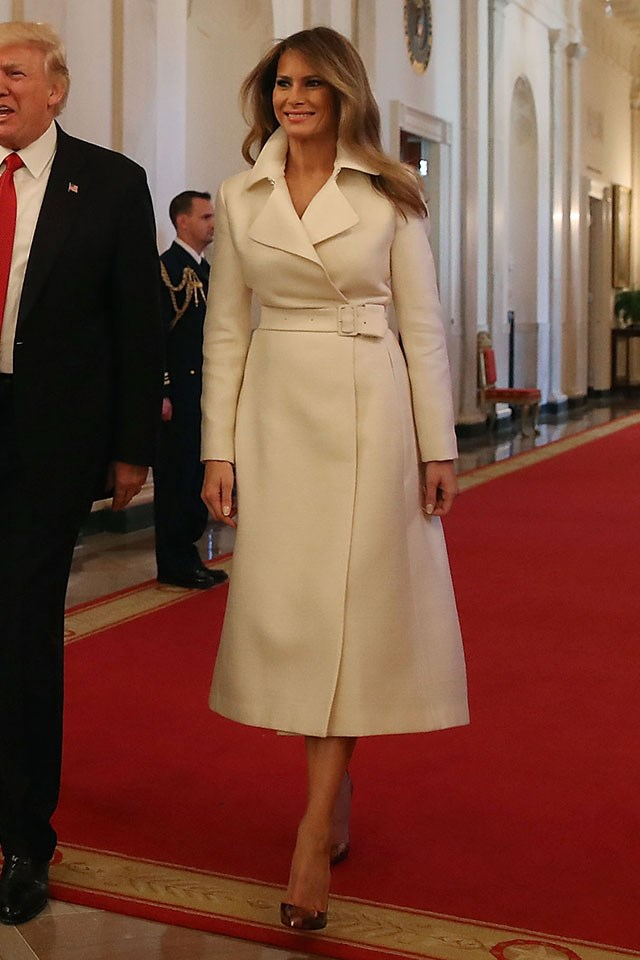 Melania wore her signature coat dress, this time an ivory version by The Row, and a pair of python Christian Louboutins to present the International Women of Courage Awards at the White House.