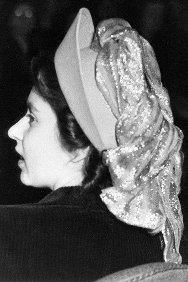 <strong>GLITTER SCARF</strong> <p><p> As women in their 20s do, Princess Elizabeth (photographed here, five years before she became queen) experimented with some glitter — albeit, with a cascading scarf-hat hybrid, which is maybe not the same as too much silver eyeshadow.