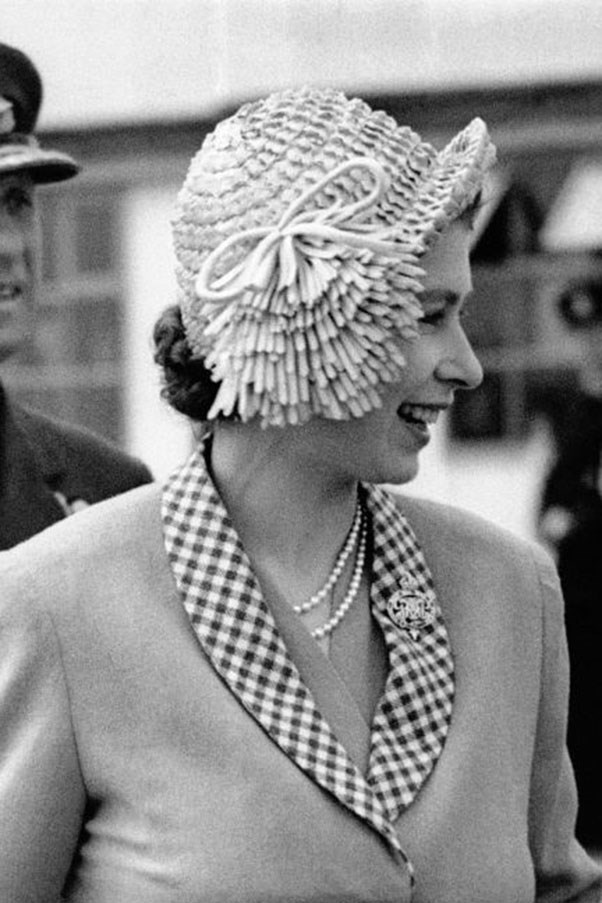 <strong>SIDE-SWEPT CLOCHE</strong> <p><p> In 1949, the then-Princess wore an, ahem, interesting, cloche hat with a side-swept fringe detail while being escorted by her husband, the Duke of Edinburgh, from an airport in London.