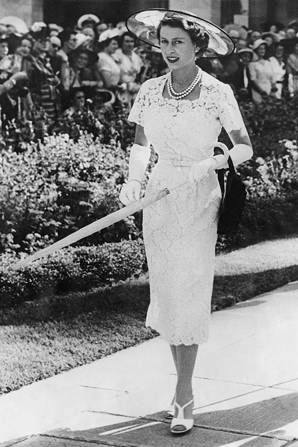 <strong>BLACK TULLE</strong> <p><p> Before departing Australia in 1954, 28-year-old Queen Elizabeth donned a slim-fitting lace dress to a garden party. It's rumored that she carried around the parasol simply because it matched her sheer, black-tulle hat. Looks like the Queen made a few sacrifices in the name of fashion, just like the rest of us.