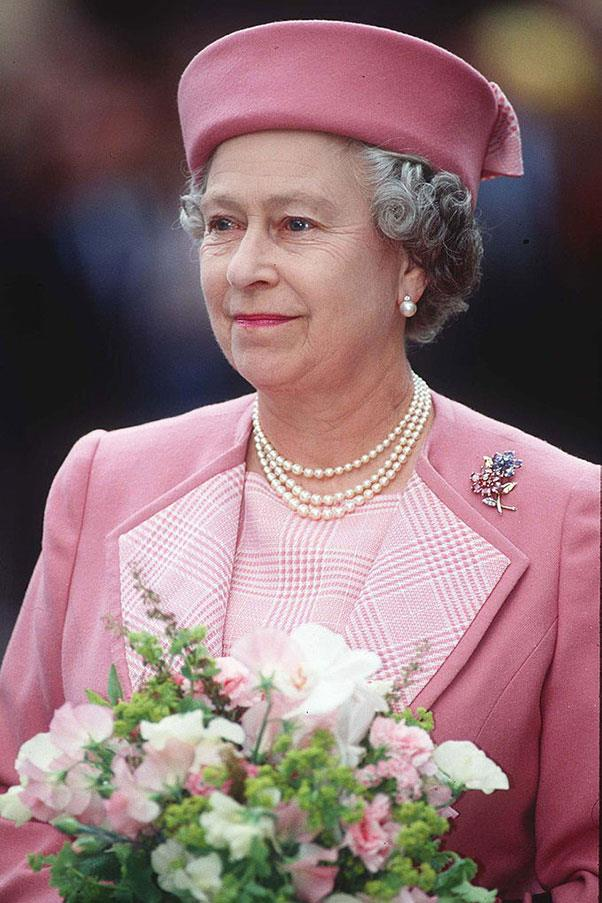 <strong>PINK PILLBOX</strong> <p><p> The Queen, looking pretty in a pink pillbox hat, in 1992.
