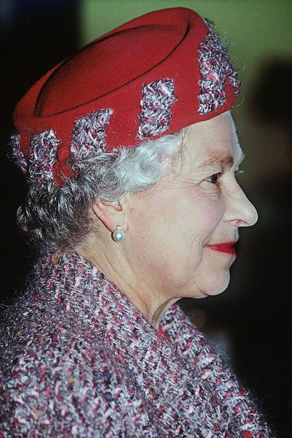 <strong>BOUCLÉ STRIPES</strong> <p><p> On a royal trip to Reading in 1992, the Queen wore this brimless felt hat, indented with stripes to match her bouclé coat — one of her more adventurous looks, for sure.