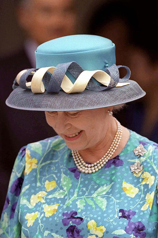 <strong>SPIRALIZED</strong> <p><p> While visiting a shelter for children in Malaysia, Queen Elizabeth donned this three-tone spiral hat.