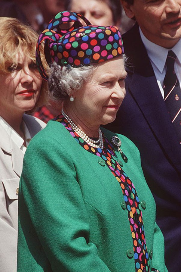 <strong>POLKADOT PILLBOX</strong> <p><p> The Queen paired her emerald jacket, trimmed with an eclectic polkadot pattern, with a matching pillbox hat.