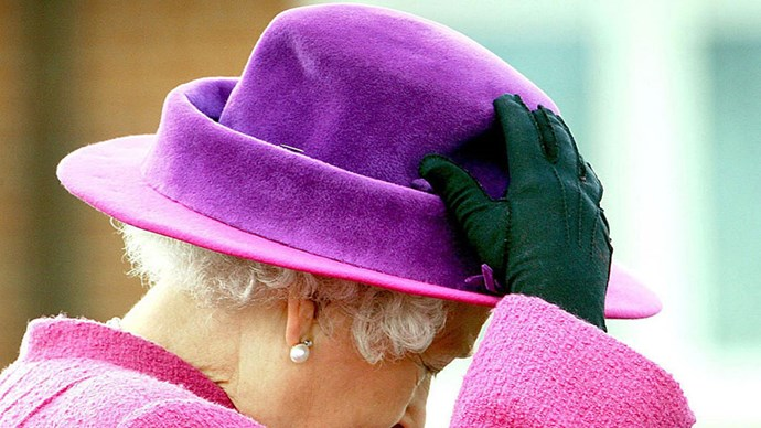 <strong>PINK AND PURPLE COLOR BLOCK</strong> <p><p> Queen Elizabeth II, keeping color-blocking en vogue since forever.
