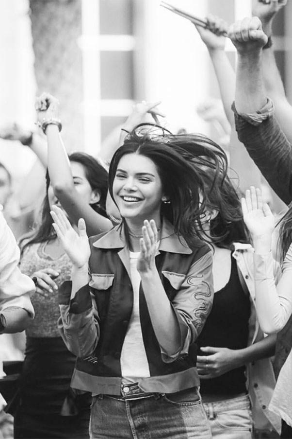 """<strong>Réalisation Par</strong><br><br> Kendall Jenner wore the 'Japan' jacket by cult Australian label Réalisation Par in her new commercial for Pepsi.  <br><br> Image: Instagram <a href=""""https://www.instagram.com/p/BSdfX3ggsAD/"""">@realisationpar</a>"""