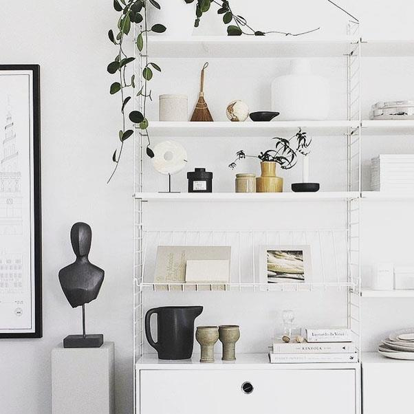 """<strong>Think upwards</strong> <br><br> If you don't have the space to go sideways, go upwards! Your room doesn't stop at eye level – make the most of the whole wall space and introduce some high shelving. Display framed prints, books and metallic accessories or even designer shopping bags that can be displayed and used for hidden storage. As well as providing a practical out-of-the-way storage solution, this draws the eye upwards to another area of the room, highlighting the extra space. <br><br> <em>Image: </em><em><a href=""""https://www.instagram.com/p/BSUtsA9g5rV/"""">@ludasmithinteriors</a></em>"""