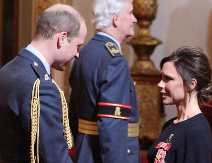 Victoria Beckham receives OBE from Prince William