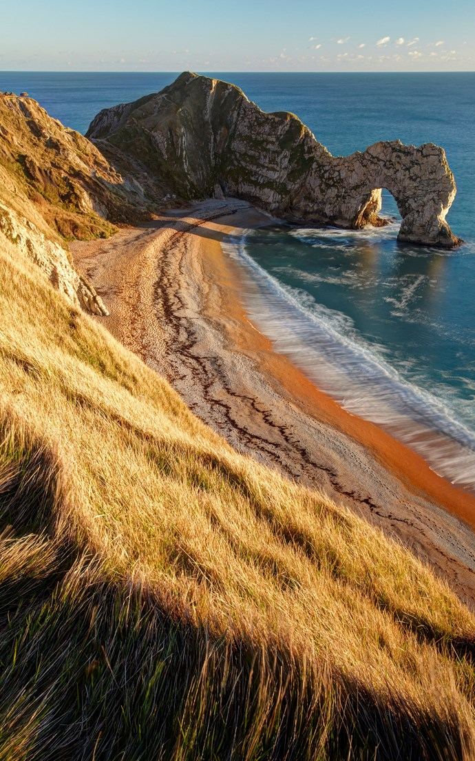 <p><strong>Durdle Door, England</strong> <p>Set upon the Jurassic Coast between Swanage and Weymouth, this natural limestone arch is the perfect secluded cove for your next Insta-worthy travel diary.