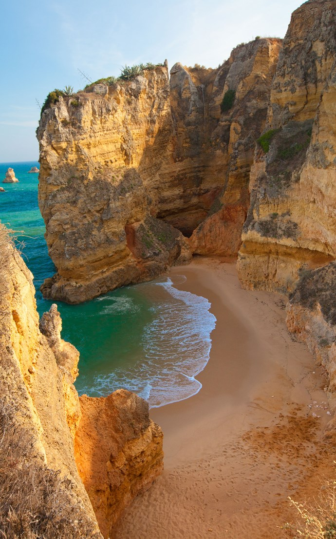 <p><strong>Praia Dona Ana, Portugal</strong> <p>Surrounded by cliffs, this small beach outside of Lagos is one of the most beautiful in Portugal's Algarve region.