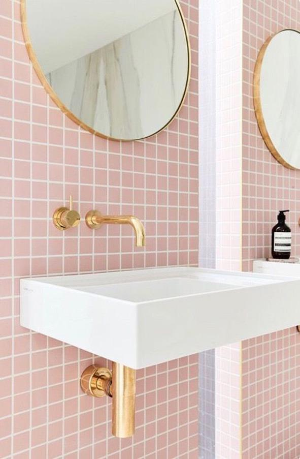 <strong>Pink Accents</strong> <br><br> Didn't you hear? Millennial pink is everywhere now. Yes, that means your vintage pink tile bathroom is cool again.