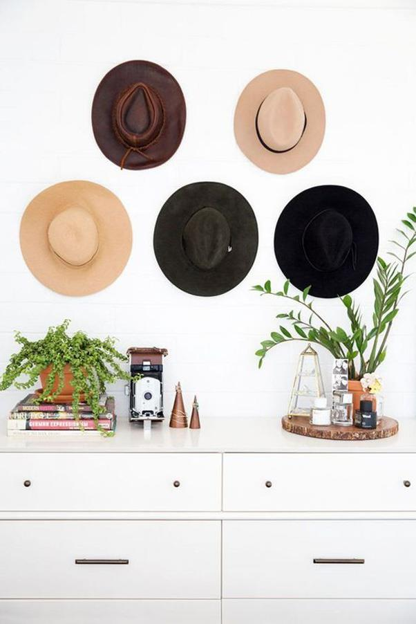 <strong>Accessories as Décor</strong> <br><br> Hanging your hats on the wall is a 2-for-1 design idea that personalises your space and saves your favourite accessories from getting lost in the back of your closet.