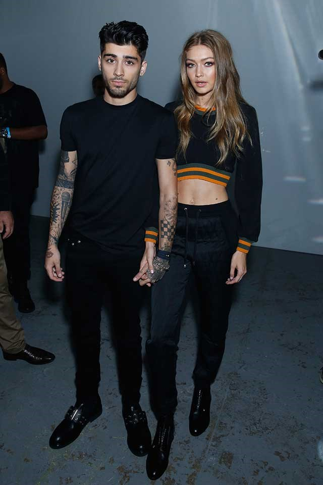 <strong>When:</strong> September, 2016<br> <strong>What:</strong> Gigi and Zayn make a convincing case for couple dressing in all-black ensembles, Gigi's distinguished only by colour pop tangerine stripes and a hint of midriff.<br><br>