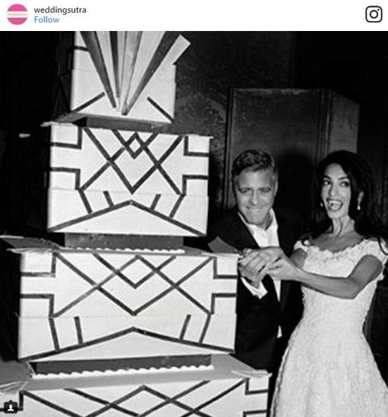 "<p><strong>George Clooney & Amal Alamuddin</strong> <p>Would you expect anything less than classic elegance from Clooney and Alamuddin? The couple cut into a four-tiered, square-style art deco chocolate wedding cake at their Venice wedding. <p><em>Via: <a href=""https://www.instagram.com/p/9qzhkvxzVc/"">@weddingsutra</a></em>"