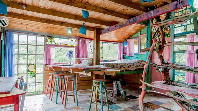 """<strong><a href=""""https://www.airbnb.com.au/rooms/172391"""">Cabana Floripa</a> in Florianopolis, Brazil</strong>.<p><p> This ecletic little stay gives you a view of the mountains and a colourful background for your food 'grams. <p> $104 per night"""