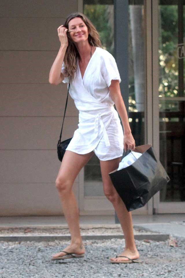 """<strong>Lilya</strong><br><br> Gisele Bündchen steps out on holiday in Costa Rica wearing an effortlessly chic linen mini by Australian brand, Lilya. <br><br> Shop the Roni dress <a href=""""http://www.ilovelilya.com/products/Roni-Mini-Dress-White-825.htm"""">here</a> for $179."""