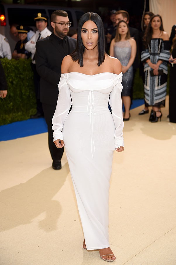 """<strong>Kim Kardashian West in Vivienne Westwood</strong><br><br> """"I love this! Fresh, beautiful, chic—and unexpectedly demure."""" - Stephanie Huxley, deputy art director<br><br> """"Kim is copping a lot of flak for this online, but I think it's one of her best red carpet appearances to date. It's restrained, sophisticated and extremely flattering - a welcome departure from the OTT choices of yesteryear."""" - Grace O'Neill, acting digital fashion editor<br><br> """"This look is better than the couch disaster of Met Gala's past, but I feel like Kim rolled out of bed in her nightie this time around. I totally understand why she's trying to be less flashy (and props to her for it) but this doesn't seem like the time or place."""" - Kate Moffatt, digital weekend editor<br><br> """"I really admire the simplicity of this look. It's effortless and beautiful."""" - Caroline Tran, junior fashion editor"""