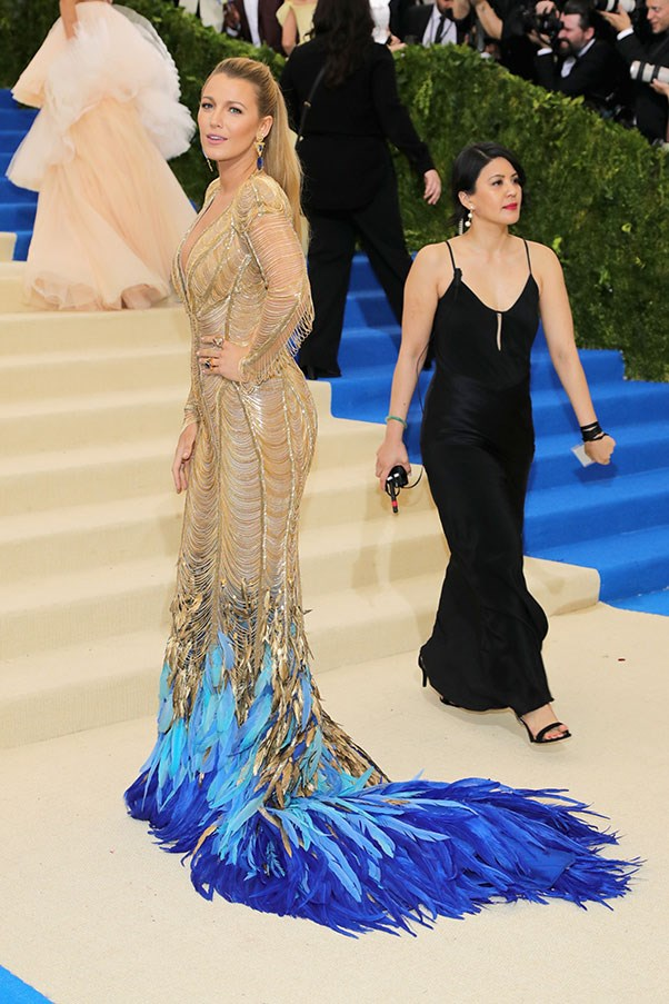 """<strong>Blake Lively in Atelier Versace</strong><br><br> """"I know it's Versace, and I know she's a goddess, but this is feathered train comes too close to the ridiculous for me to take this seriously."""" - Alison Izzo, digital managing editor<br><br> """"You know that Chanel quote about taking one thing off before leaving the house? She meant that for Blake."""" - Anna Lavdaras, beauty writer<br><br> """"She looks like a mermaid crossed with a peacock."""" - Caroline Tran, junior fashion editor"""