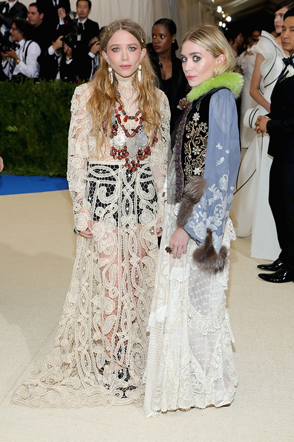 """<strong>Mary-Kate and Ashley Olsen</strong><br><br> """"Leaving aside any feelings about the fiddly harp-tutor vest and the roadkill-tufted sleeves, it's hard to see what they were going for here."""" - Tom Lazarus, chief subeditor<br><br> """"I know many will disagree with me here, but I this level of co-ordinated eclecticism takes skill, and I applaud it."""" - Alison Izzo, digital managing editor<br><br> """"The understated Queens of the Met Gala red carpet. Who/what are they wearing? No-one knows, and it doesn't matter anyway. Special props to Ashley's green fur-lined jacket, which looks like it was fished out of a vintage store in Silverlake (in the best possible way) but is probably a $15,000 custom job."""" - Grace O'Neill, acting digital fashion editor"""