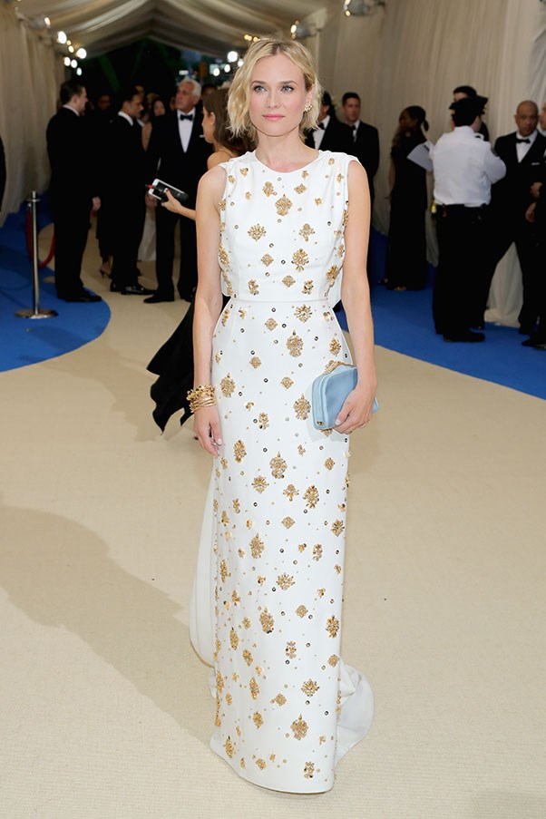 """<strong>Diane Kruger in Prada</strong><br><br> """"Diane looks phenomenal. Does she not age?"""" - Stephanie Huxley, deputy art director<br><br> """"This look has really grown on me – I love how clean and fresh the white is paired with the beautiful and the powder blue clutch. Kind of magic."""" - Caroline Tran, junior fashion editor"""