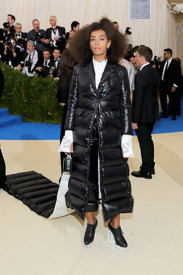 """<strong>Solange in Thom Browne</strong><br><br> """"One can have too much puffer fabric in one's life."""" - Jessica Matthews, deputy chief subeditor<br><br> """"Bold, irreverent, a fitting tribute to a fashion provocateur and the ultimate foil to frigid air-conditioning."""" - Tom Lazarus, chief subeditor"""