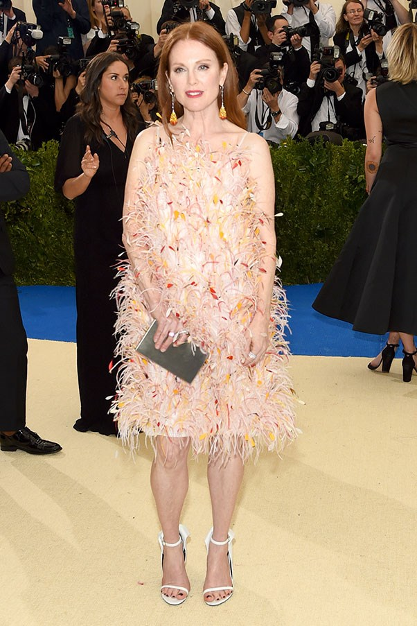 """<strong>Julianne Moore in Calvin Klein by Appointment</strong><br><br> """"This feathered confection is just perfect for the actor. Maybe it's because the embellishment matches her hair and skin tone. Or maybe it's that she heavyweight enough wear something that would so easily overwhelm someone less confident."""" - Clare Maclean, executive editor, fashion<br><br> """"This is magic. The colour with Julianne's hair is heaven and I love the playfulness of the feathers. The runway version is one of my favourite FW looks."""" - Caroline Tran, junior fashion editor"""