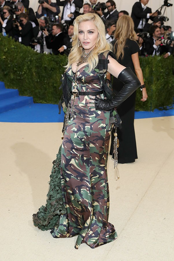 """<strong>Madonna in Moschino</strong><br><br> """"So Madonna chose to pay homage to an avant-garde Japanese designer with ill-fitting camouflage. Interesting."""" - Anna Lavdaras, beauty writer."""
