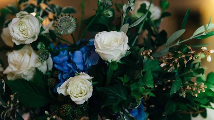 <strong>On the flowers: </strong> <br><br> I took into consideration the venue, location and my love of blue hydrangeas. These were my feature flower. I never wanted a plain white bouquet, so I worked with my florist on the colour scheme of white, green and blue interspersed with lots of mint (which smelt divine). Bec has a soft, feminine and a slightly edgy signature style, which is why I choose her. My only direction was strictly no natives. We left it too late to get an Arbour, so very last minute Bec organised to make a garland instead and hang in the tree that stood behind us where we got married. She also created beautiful urns on either side of the aisle, which looked absolutely gorgeous.