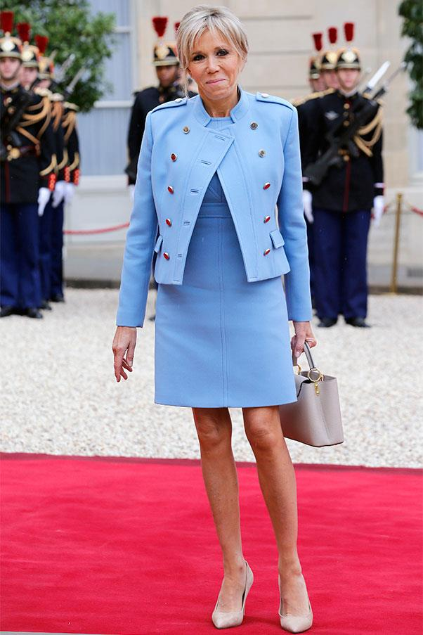 "Brigitte Macron wore a Louis Vuitton blue suit, reminiscent of the Ralph Lauren suit <a href=""http://www.harpersbazaar.com.au/people-parties/the-a-list/2017/4/melania-trump-style-file/melania-trump-style-file-image-41/"">worn by Melania Trump</a> to President Donald Trump's inauguration, to her husband's inauguration."