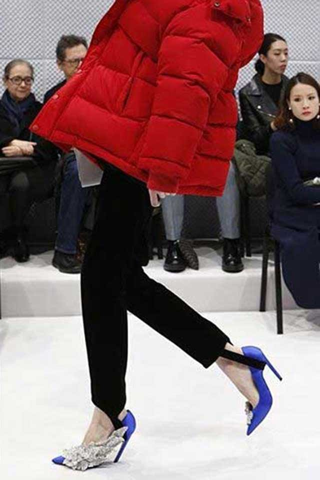 """In part, you have Balenciaga to thank. Its bejewelled satin stiletto of AW16 was like the Hangisi's hyper-maximalist younger sister, its crystals clumped together like ritzy barnacles — all glamour, all glitter, all the makings of a shoe of the season. And it was. It also helped create a thirst for the style. Image: <a href=""""https://www.instagram.com/p/BCsTH9IglQ6/"""">@balenciaga</a>"""