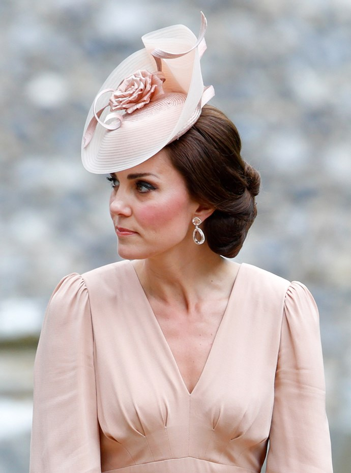 Kate Middleton attended sister Pippa's wedding today wearing a custom-designed Sarah Burton for Alexander McQueen gown.