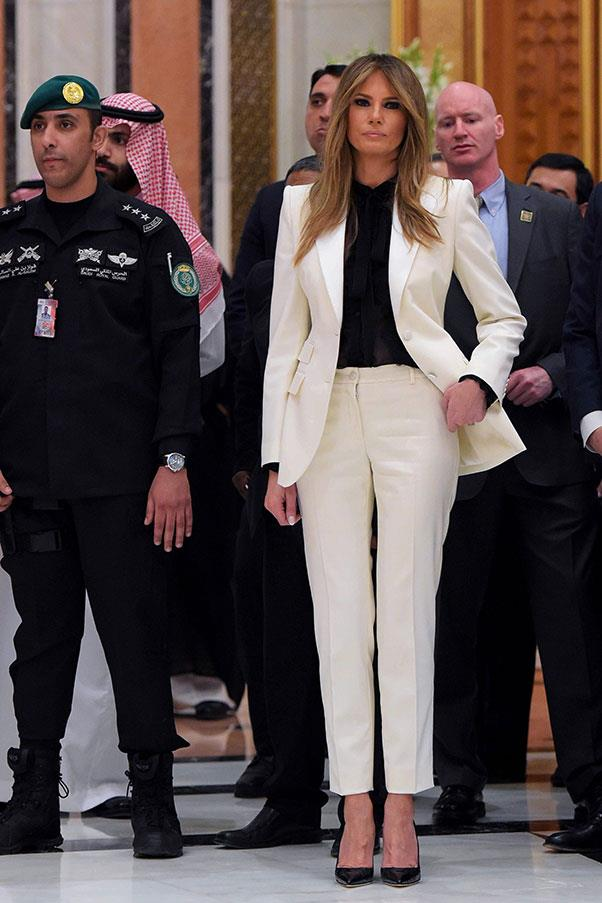 The First Lady wore a white fitted pant suit to an event during the President's tour of Saudi Arabia, May 2017.