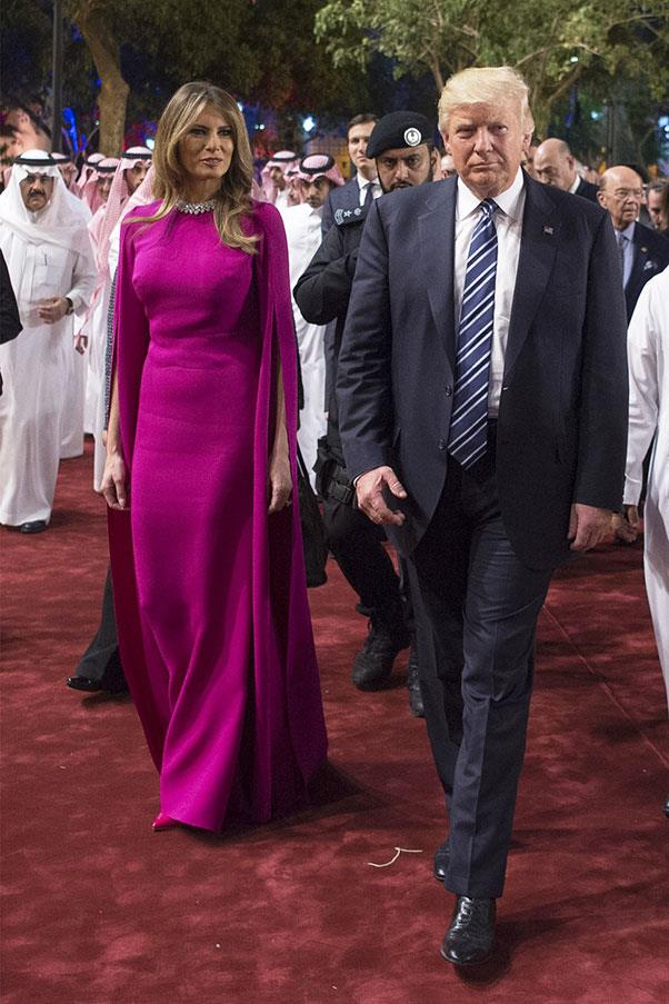 The First Lady wore a floor-length magenta gown to a dinner honouring her husband, President Donald Trump, in Saudi Arabia.<br><br> Image: Bandar Algaloud/Saudi Royal Council