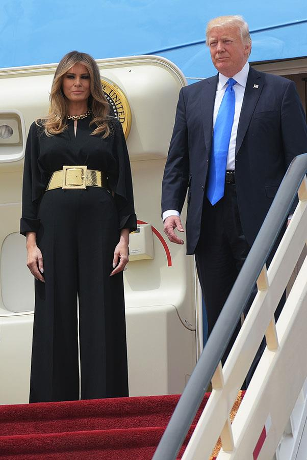 "Melania Trump wore a black pansuit and oversized gold belt as she arrived in Saudi Arabia. The First Lady has courted controversy for choosing to forgo a head scarf, as her husband <a href=""http://www.harpersbazaar.com.au/news/culture-club/2017/5/melania-trump-head-scarf-saudi-arabia/"">criticised Michelle Obama</a> for the same reason during Obama's presidency."