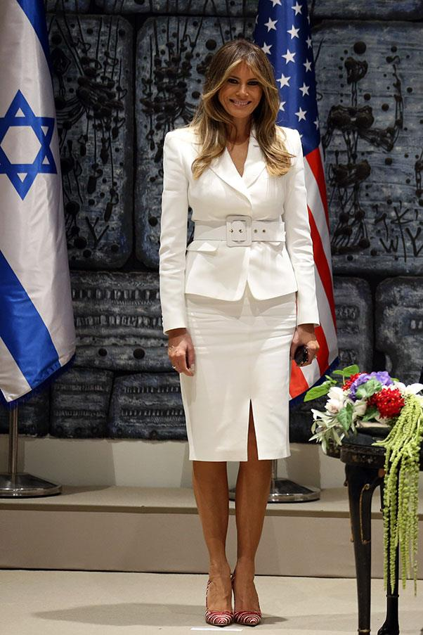 The First Lady wore a white skirt suit and red and white striped pumps as she landed in Israel for an official international tour with husband Donald Trump,