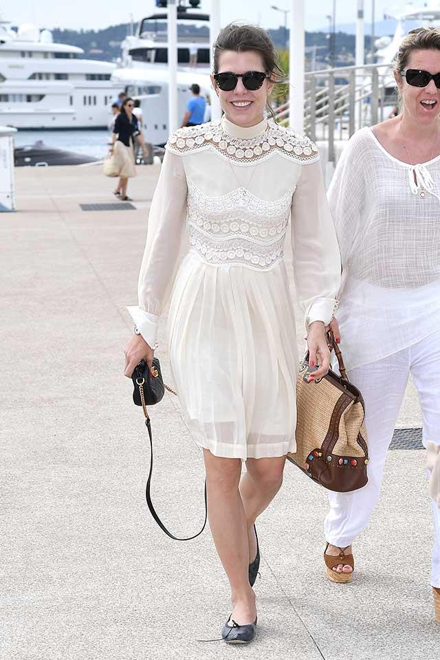Wearing Gucci as she arrives at Cannes Film Festival by private boat.