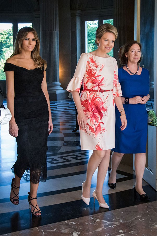 Trump wore an off-the-shoulder black dress to meet Queen Mathilde of Belgium at the Royal castle in Laken.