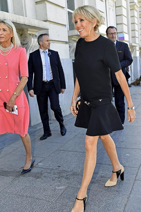 Macron wore a black dress and Louis Vuitton handbag to meet US First Lady Melania Trump in Brussels.