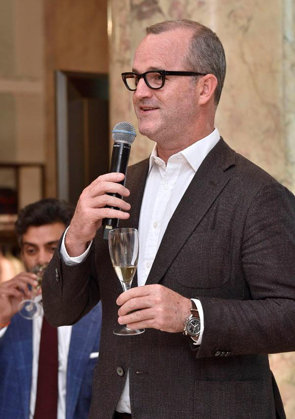 Burberry's general manager John Mutton toasts the occasion.