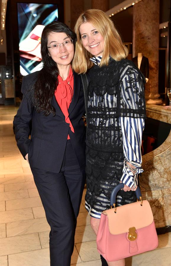 Kellie Hush poses with a guest and a bag from Burberry's DK88 collection.