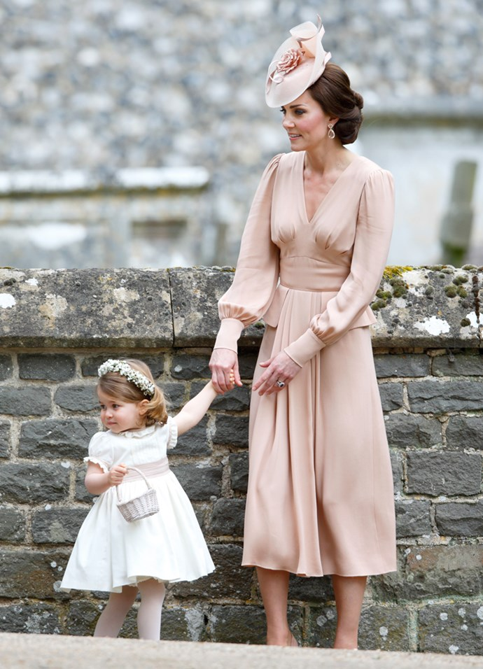Last month, the Duchess wore this pale blush Alexander McQueen gown to Pippa Middleton's wedding. It featured balloon sleeves and a pin-tuck back.