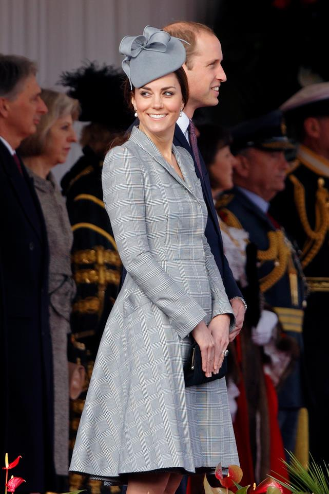 Middleton attended the ceremonial welcome for Singapore's President wearing a tailored grey stripe Alexander McQueen dress in 2014.