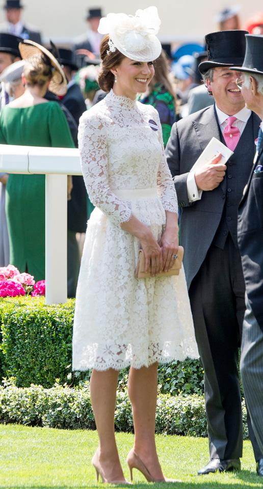 Kate looked chic in a white lace Alexander McQueen gown at the Royal Ascot Races today.