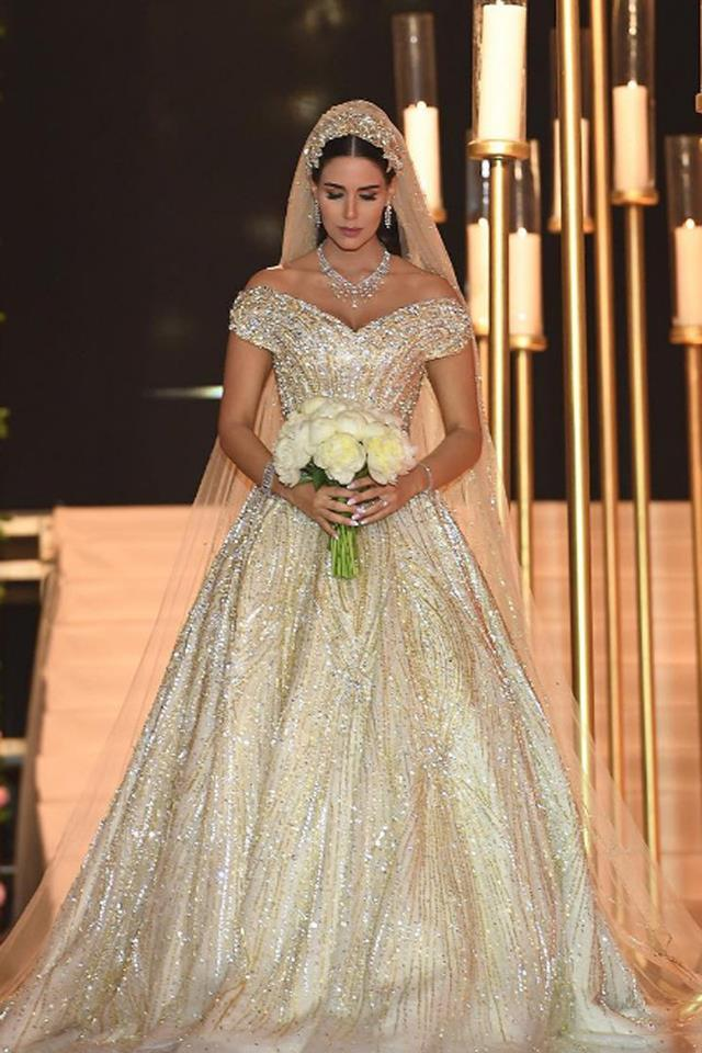 <strong>Dana Wolley</strong><br> Dana Wolley, a Middle Eastern fashion influencer, wore a bespoke Atelier Esposa gown to her 2016 wedding. It was fully hand-beaded with thousands of Swarovski crystals that took over two months to attach, and was so-over-the-top it had its own hashtag. The cost? Over a million dollars.