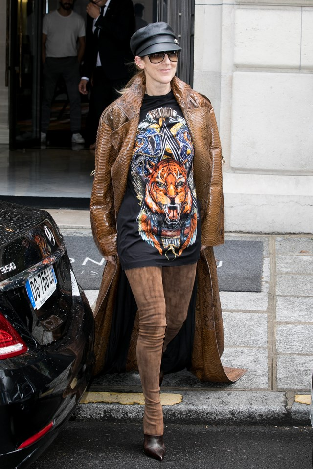 Dion stepped out in Paris wearing a Balmain crocodile coat and thigh-high boots.
