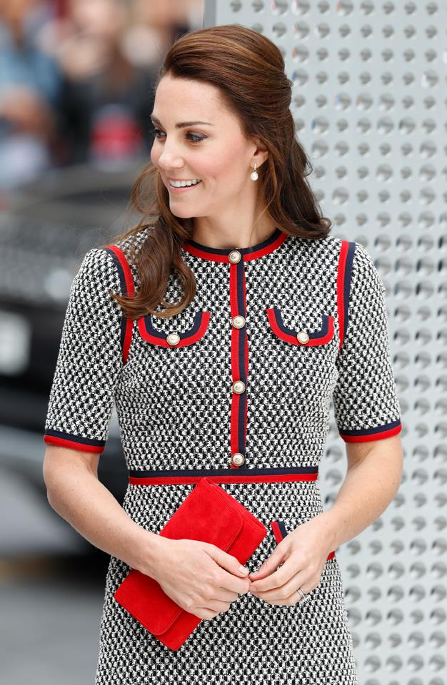 Kate stepped out yesterday wearing an impeccable tweed Gucci suit, which she aptly paired with this cherry red clutch.
