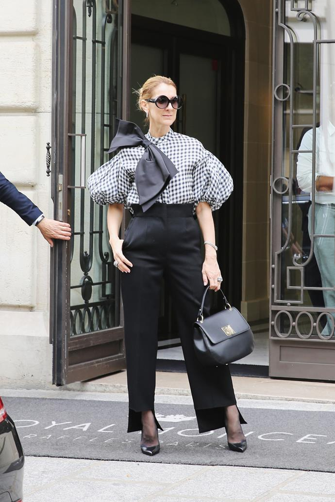 Celine paired her Dice Kayek shirt with black pants, Tom Ford heels and the biggest bow we've ever seen while out and about in Paris.