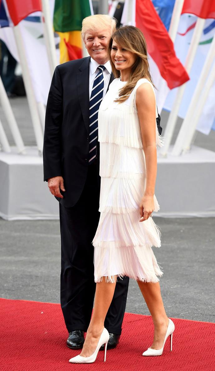 Melania emerged unscathed from the G20 drama in a white flapper dress by Michael Kors and Christian Louboutin heels.
