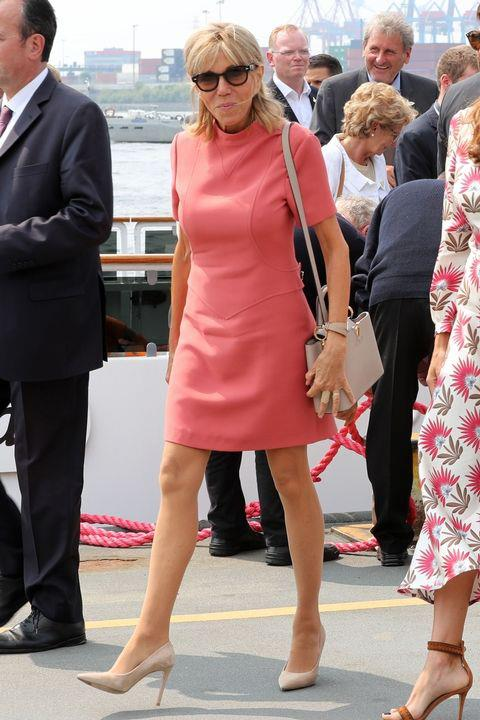 The French First Lady wore a chic salmon-coloured minidress and nude pumps while out in Germany this weekend.